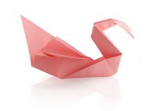 Origami swam. Pink tender origami swam on the white reflecting background Stock Photo