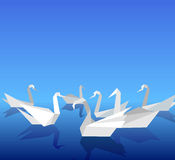 Origami swans. Royalty Free Stock Photography