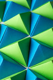 Origami tetrahedrons in blue, yellow and green colors. Royalty Free Stock Images