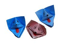 Origami - three lovely dogs. Origami is the art of paper folding which can unite children and adults. This way of paper folding gives positive emotions to anyone stock photos