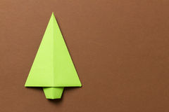 Origami tree. Paper origami tree laying on colorful plain background Royalty Free Stock Photos