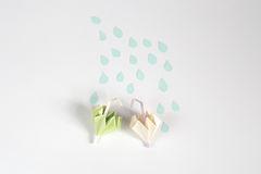 Origami umbrella and rain concept Stock Photography