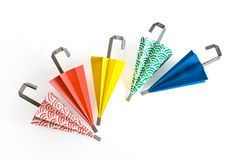 Origami umbrellas. Paper umbrella in different colours royalty free stock image