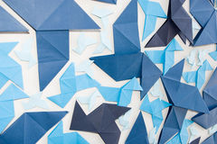 Origami wall. Origami craft background from blue paper Royalty Free Stock Photo