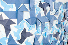 Origami wall. Origami craft on the wall from blue paper Stock Photos