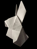 Origami white hare isolated on black Stock Photos