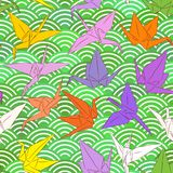 Origami white paper cranes set sketch seamless pattern. line Nature oriental background with japanese wave circle pattern red yell. Ow purple colors on green Royalty Free Stock Photo