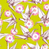 Origami white paper cranes set sketch seamless pattern. Nature oriental background with japanese Sakura flowers and birds pastel c. Olors on light green Royalty Free Stock Photo