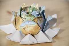 Origami world flower. Origami world lotus flower. The earth is a living being concept stock images