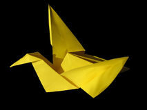 Origami yellow crane isolated on black Royalty Free Stock Photos