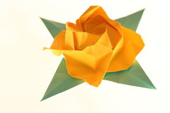 Origami yellow rose. On a white background stock photo