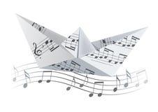 Origamiboot op de golf met muzieknoten Stock Fotografie