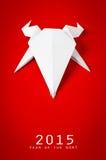 Origamidocument geit op rode achtergrond Nieuw jaar Stock Foto