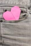 Origamihjärta i grått jeanfack Royaltyfri Fotografi