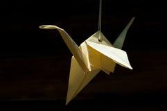 Origamin skyler över brister draken Arkivbilder