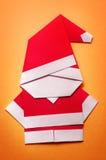 OrigamiSanta Claus pappers- hantverk royaltyfri foto