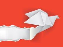 Origamivogel, der Papier zerreißt Lizenzfreie Stockfotografie