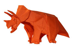 Origamy dinosaur Triceratops isolated on white. Origami traditional Japanese art make figure from paper Stock Image