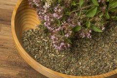 Origanum vulgare oregano herb - spice. On a table stock photos
