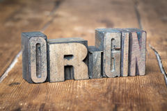 Origin word wood. Origin word made from wooden letterpress type on grunge wood royalty free stock images