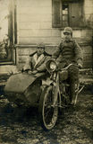 Original 1919 antique photo-men on bike. Taken in the north of Italy in 1919. Tree men in uniform on a motorbike during the fascist age royalty free stock photography