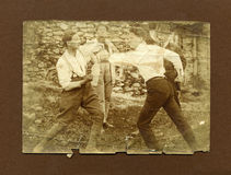 Original 1920 antique photo-men fighting. Taken in the north of Italy in 1920.Two men fighting during a boxing match royalty free stock photos