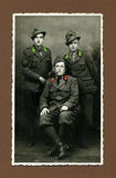Original 1943 antique photo-military man. Taken in the north of Italy in 1943. Tree men in uniform during the fascist age stock image