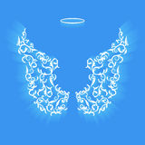 Original angel wings. Angel design elements - wings and halo isolated on the blue background. Abstract vector illustration of ornamental elegant angel wings Royalty Free Stock Images