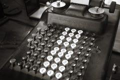 Original antique typewriter calculator in sepia tone Stock Photos