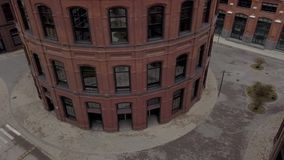 Modern architecture urban building in circular shape aerial view. Original architecture of brick buildings in cylindrical shape on territory old factory in a stock video
