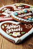 Original bavarian Oktoberfest gingerbread heart on wood.  royalty free stock photography