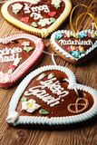 Original bavarian Oktoberfest gingerbread heart on wood stock photography