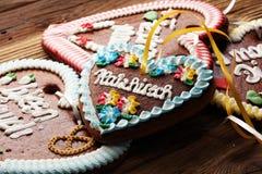 Original bavarian Oktoberfest gingerbread heart on wood.  stock images