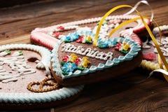 Original bavarian Oktoberfest gingerbread heart on wood.  royalty free stock image