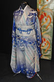A original blue Japanese women's kimono decorated with flowers and cranes Royalty Free Stock Photography