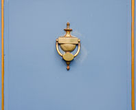 Original brass knocker in the shape of an antique vase on the bl Royalty Free Stock Images