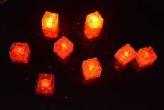 Original bright red glowing plastic cubes in total darkness. Awesome background, hellish and creepy red color, mixed glowing ice c