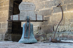 Original bronze rusty bells of the bell tower on the church Late 16th century  Gothic building  San Esteban de la Huer Royalty Free Stock Photo