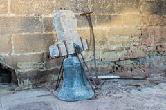 Original bronze rusty bells of the bell tower on the church Late 16th century Gothic building San Esteban de la Huerta Stock Images