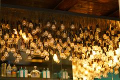 Original chandelier composed of thousands of old lamps. Very original chandelier composed of thousands of old lamps decorative classic hanging illumination royalty free stock photos