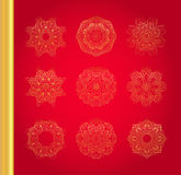 Original Christmas decoration set. Golden vector traditional snowflakes on red background Stock Image