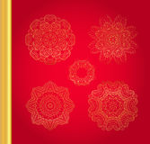 Original Christmas decoration set. Golden vector traditional snowflakes on red background Royalty Free Stock Image
