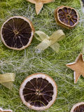 Original Christmas decorations cut from dried orange peel. Stock Photo