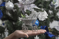 Original Christmas decorations. Toy on the Christmas tree in the form of a pram Royalty Free Stock Photography