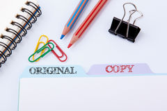 Original and Copy. Folder Register on a white Office Table.  royalty free stock photos