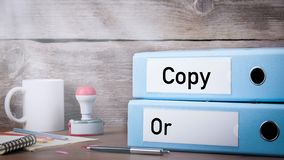 Original and Copy. Two binders on desk. In the office. Business background stock video footage