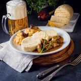 Original Czech dumpling with goulash Stock Photo