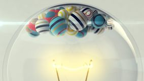Upper Part of Light Bulb with Balls. An original 3d illustration of a transparent glass ligh bulb with a a lit metallic wire and small striped and colorful Stock Images