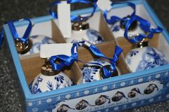 Original Delft Blue hand made baubles, Holland. Characteristic and original hand painted porcelain Delfts Blue baubles from Delft, the Netherlands. Exclusive Stock Photography