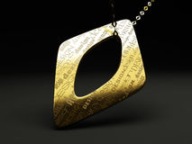The original design jewelry. The original gold pendant with chain. Engraving fonts different design Royalty Free Stock Photography